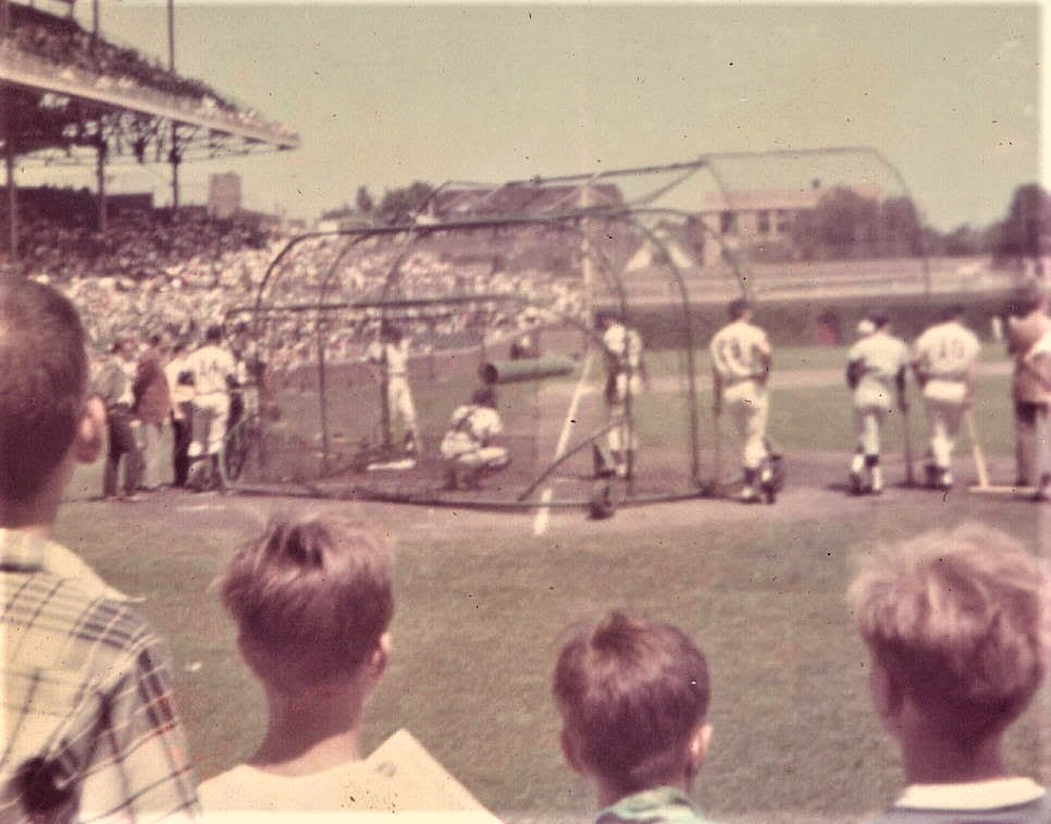 1970s era photo: youngsters watching Chicago Cubs batting practice at Wrigley Field.